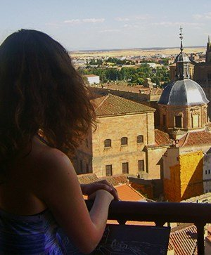 Rutgers Global – Study Abroad in Spain, student looking over balcony at Salmanca