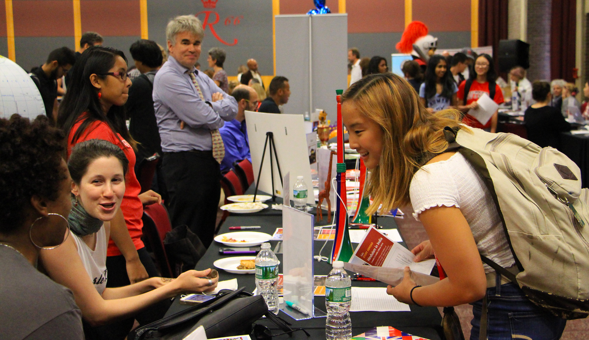 Rutgers Global - Study Abroad Fair, student asks two exhibitors for information