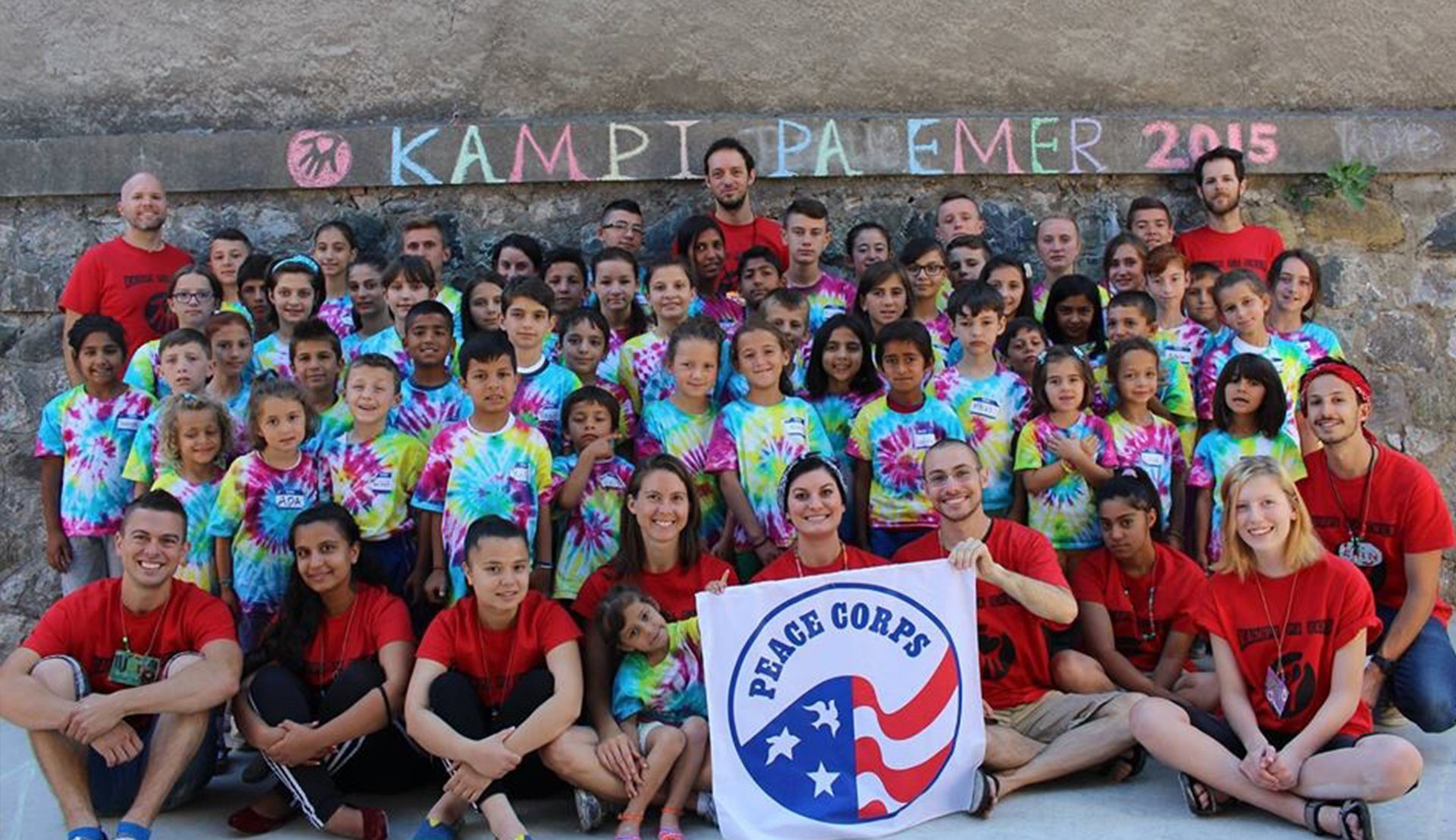 Rutgers Global – Peace Corps Professional Benefits, Jon Breen and other Peace Corps volunteers post with children at a youth center in Albania