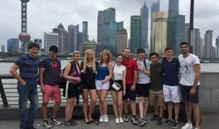 Group picture of students in front of Shanghai City scape