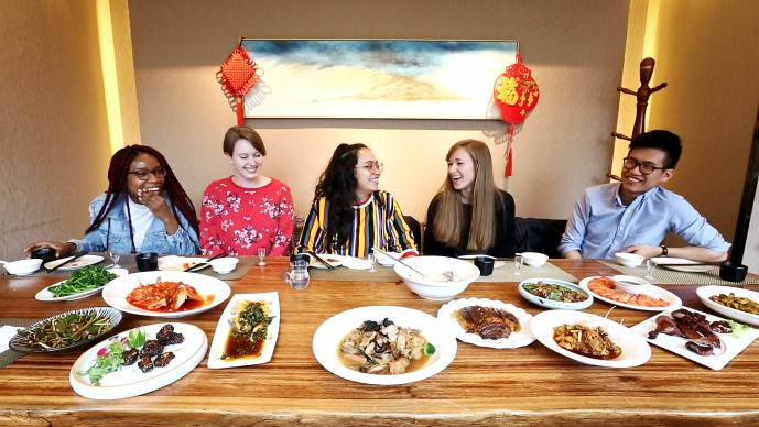USAC students enjoying traditional food in Chengdu