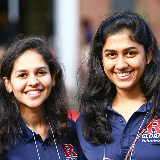 Rutgers Global – Postarrival Guide, two international student volunteer pose and smile during International Student Orientation