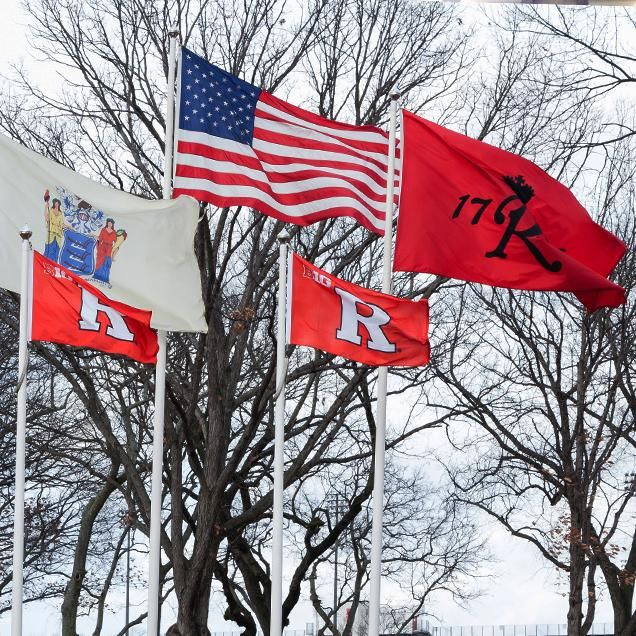 "Rutgers Global - Requesting F-2 or J-2 Documents for Dependents of International Students, five flags wave in wind against bare trees: New Jersey state flag, American flag, Rutgers 1766 flag, two Rutgers ""R"" flags."