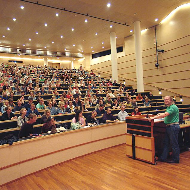 Rutgers Global – Study Abroad Resources for Faculty, professor speaking to students in large lecture hall