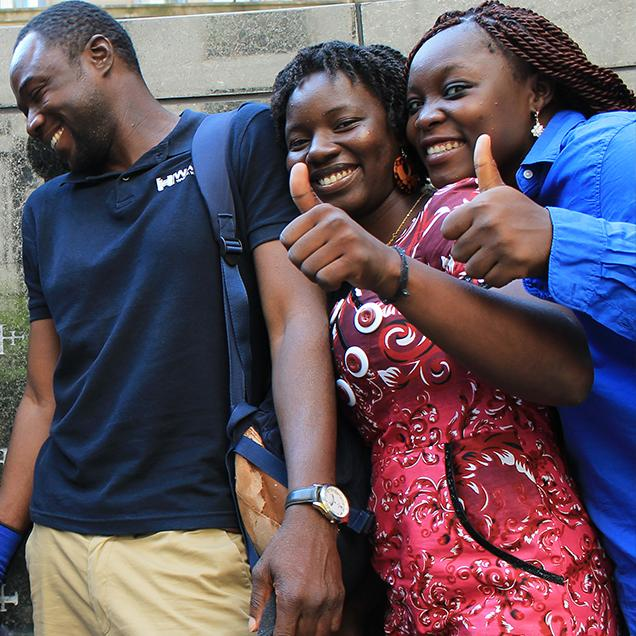 Rutgers Global – Mandela Washington Fellowship, three fellows pose during a field trip