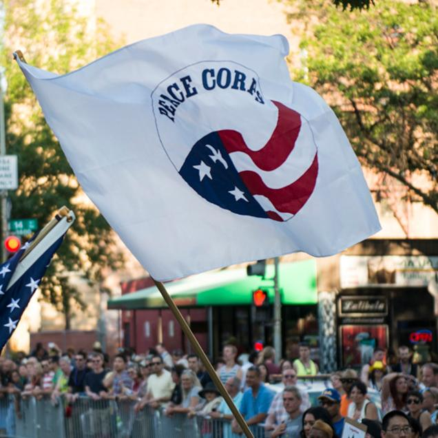 Rutgers Global - Peace Corps, Peace Corps flag waving in the middle of a crowded parade in Washington DC