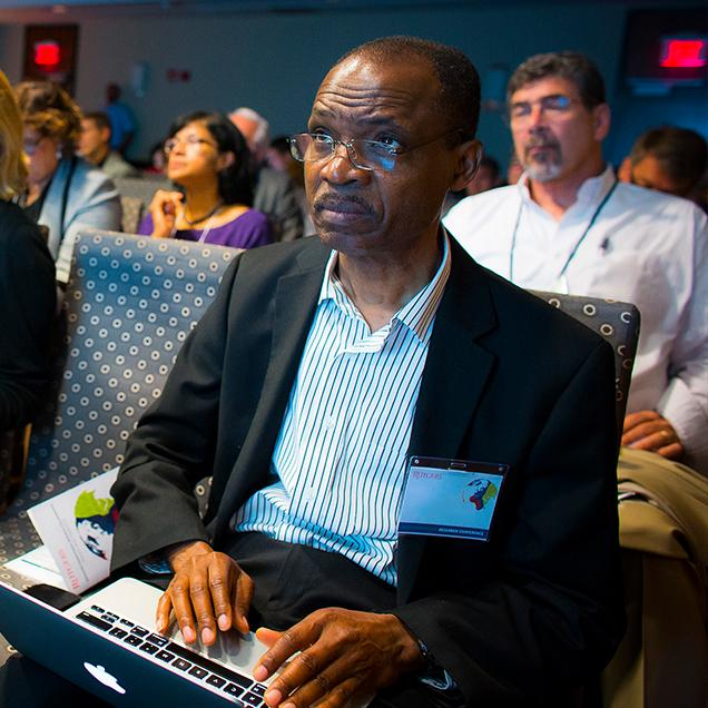 Rutgers Global – Programs and Opportunities, attendee with laptop listens to a speaker at the International Research Conference