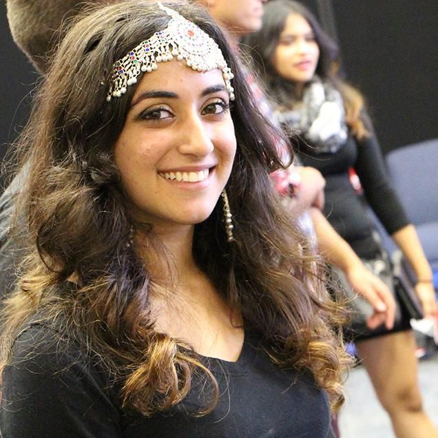 Rutgers Global – Programs and Events, a student exhibitor dons traditional headdress during the 2015 International Festival