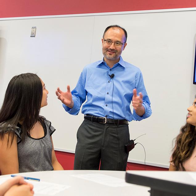 Rutgers Global - UN SDG Graduate Courses, a professor speaks to a small classroom